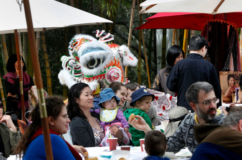 ". A dragon makes its way back to the stage at Hakone Estate and Gardens during a Lunar New Year of the Snake festival with a ""Chinese Village Fair\"" on Sunday afternoon, March 3, 2013 in Saratoga, Calif. (Karl Mondon/Staff)"