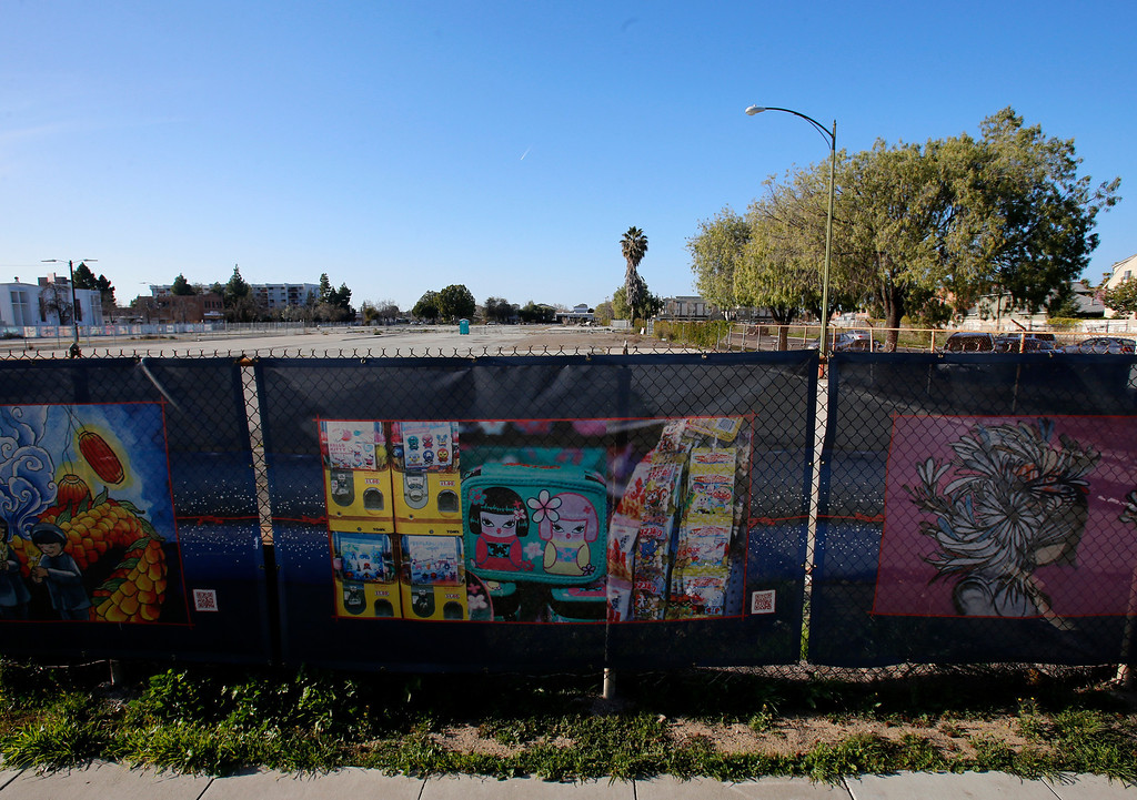 """. An empty lot at looking north on Jackson St. in-between N. 6th St. and N. 7th St. in Japantown in San Jose, Calif., on Monday, Feb. 25, 2013.  In the foreground is a mural from \""""The Japantown Mural Project.\""""  After years of on-again, off-again plans for development of five acres of the city�s former Corporation Yard in Japantown, the San Jose City Council on Tuesday is expected to approve a term sheet with a developer in an effort to revitalize Japantown with housing, retail, an urban plaza, performance space and strong historical connection.  (Nhat V. Meyer/Staff)"""