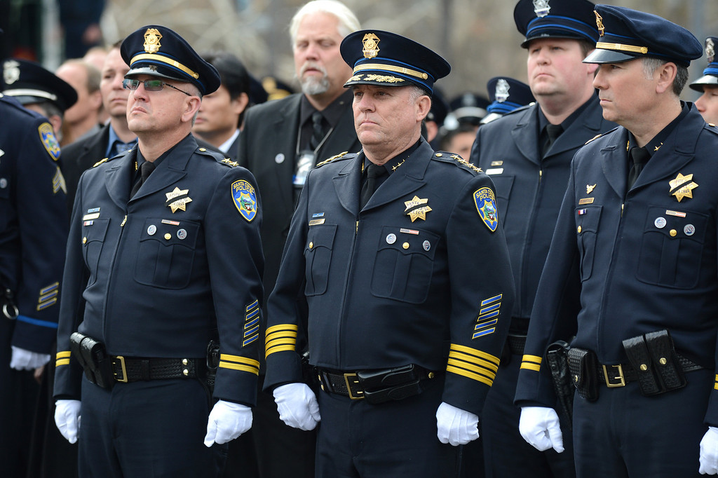 ". Members of the Santa Cruz Police Department line the street at the end of services at the HP Pavilion in San Jose, Calif., on Thursday, March 7, 2013. Thousands attended the service to remember the lives of Santa Cruz police officers Loran ""Butch\"" Baker and Elizabeth Butler, who were killed in the line of duty on Feb. 26. (Dan Honda/Bay Area News Group)"