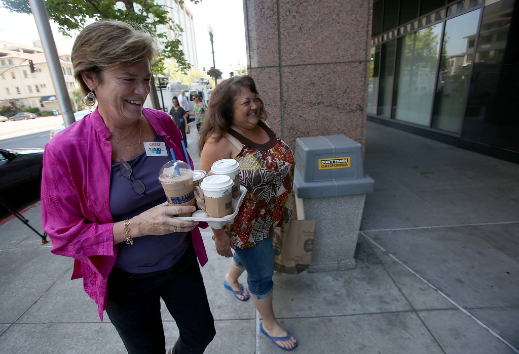 . Service Employees International Union Local 1021 lead negotiator Josie Mooney, left, and Rose Sandoval head into negotiations with BART management at the Caltrans District 4 headquarters on Grand Avenue in Oakland, Calif., on Wednesday, July 3, 2013. The BART strike is in its third day and bargaining talks resumed at 1 p.m. Wednesday. (Jane Tyska/Bay Area News Group)