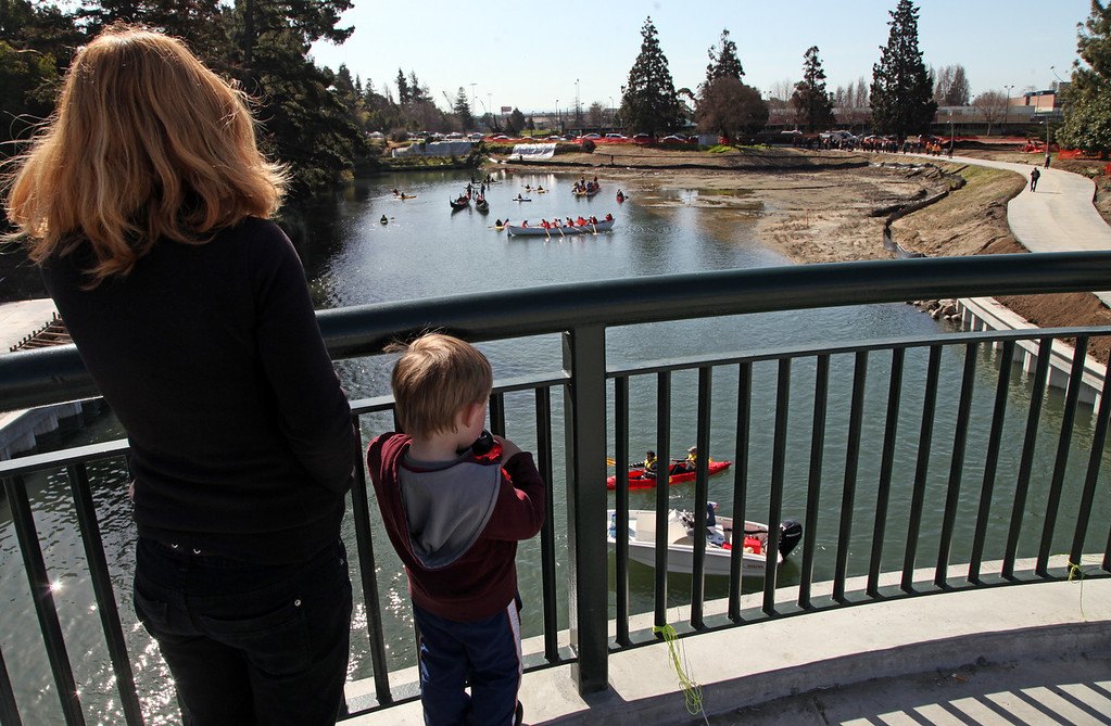 . Liam Finnegan,3, and his mother Chris Willging from Oakland came to the 12th Street bride to witness the celebration of the re-opening of a 750-foot section of the  Lake Merritt Channel in Oakland, Calif., on Friday, Feb. 22, 2013. The new 100-foot-wide free flowing tidal channel, for the first time since 1869, allows boats to travel from the Lake Merritt Channel to Lake Merritt . This is the first of a series of projects that will eventually connect Lake Merritt to the Oakland Estuary. (Laura A. Oda/Staff)