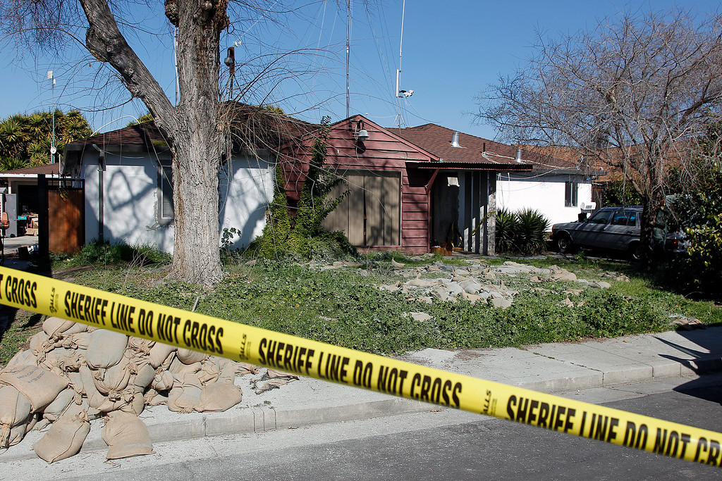 . Police tape blocks off Everett Basham\'s house on Humbolt Ave., during the search for explosive materials at in Santa Clara, Calif. on Wednesday, Feb. 13, 2013.   (LiPo Ching/Staff)