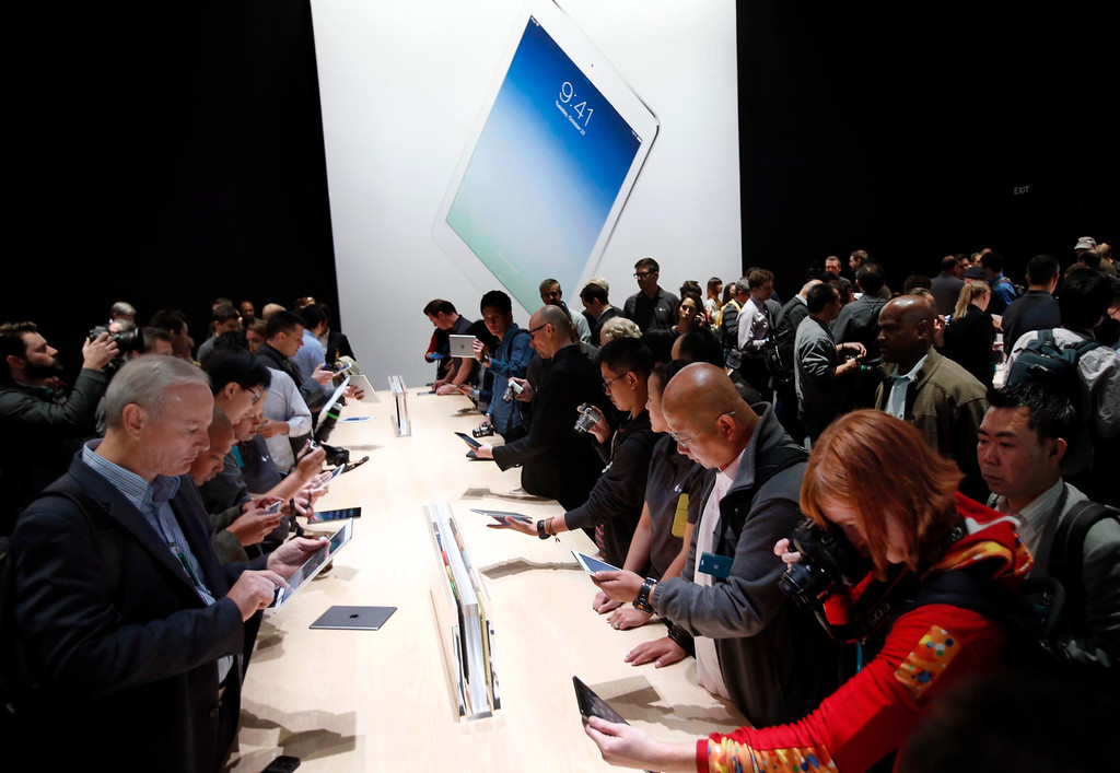 ". Apple debuted its latest iPad models Tuesday Oct. 22, 2013 in San Francisco, Calif., announcing a thinner body and a new name for the 10-inch tablet, dubbing it the iPad Air, and giving the iPad Mini its high-definition ""Retina\"" display.  (Karl Mondon/Bay Area News Group)"