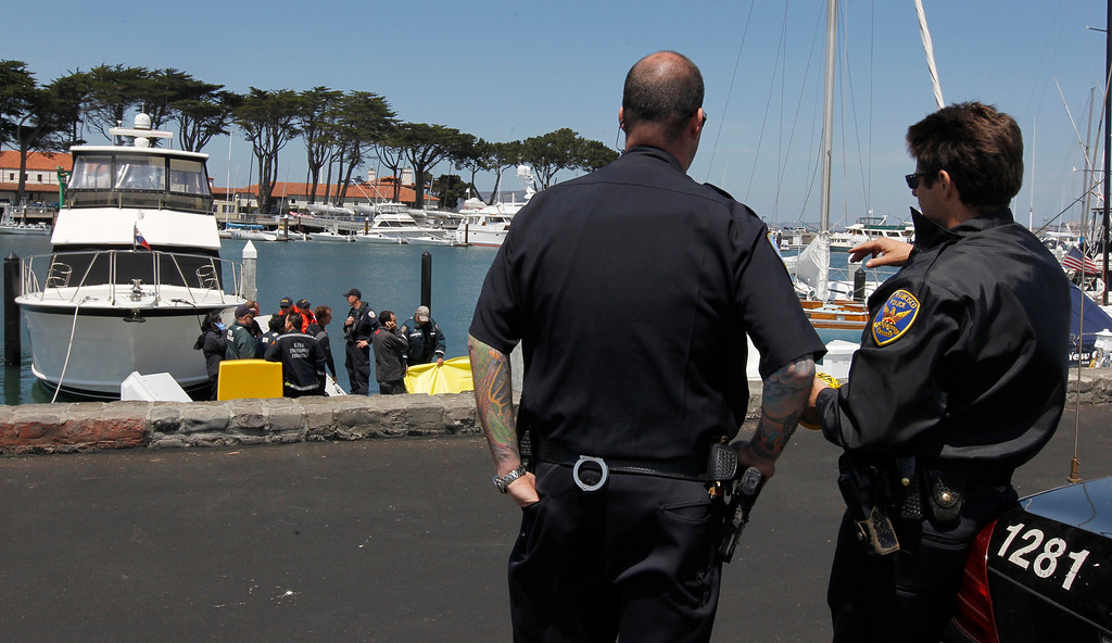 . Police officers protect the scene where attempts to revive sailor Andrew Simpson, of Great Britain, were unsuccessful, Thursday, May 9, 2013, in San Francisco, Calif. Simpson died after the Artemis Racing AC72 catamaran, an America\'s Cup entry from Sweden, capsized during training in San Francisco Bay, the team said.  (AP Photo/San Francisco Chronicle, Paul Chinn)