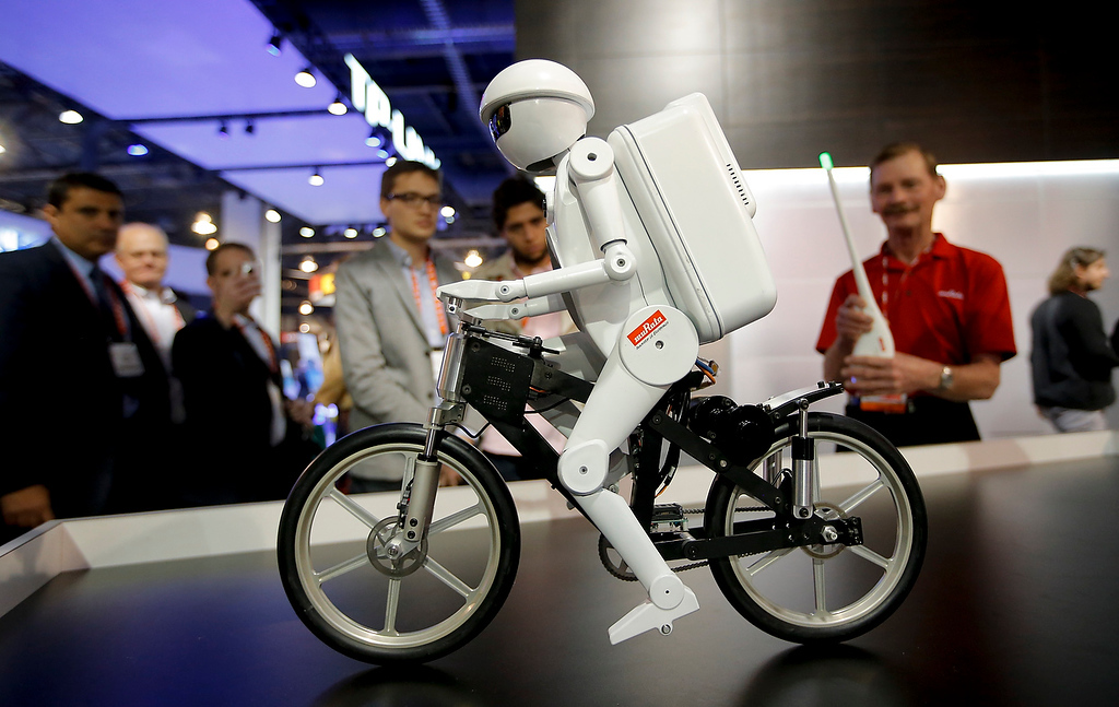 . Murata Boy, a bicycle riding robot, rides a bike at the Murata booth at the at the International Consumer Electronics Show in Las Vegas, Tuesday, Jan. 8, 2013. (AP Photo/Jae C. Hong)