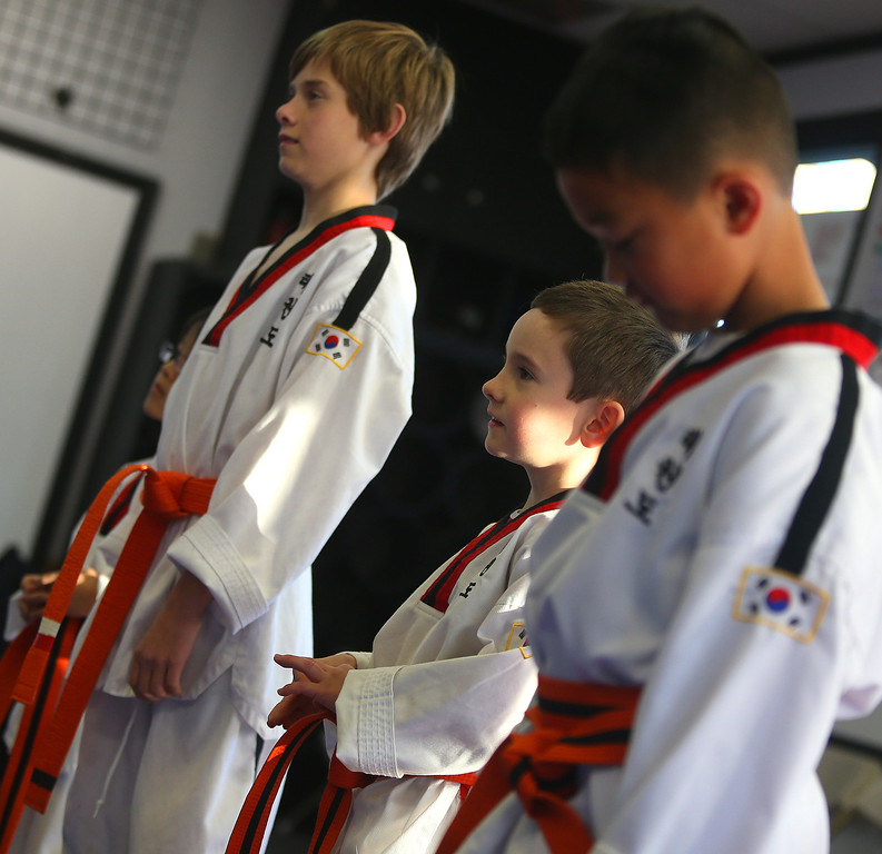 . Sammy Masek, 6, second from right, waits for his martial arts class to start on Monday, Feb. 11, 2013 in Pleasanton, Calif.  Masek is one of a growing number of children that have lost their diagnosis of autisim.  (Aric Crabb/Staff)