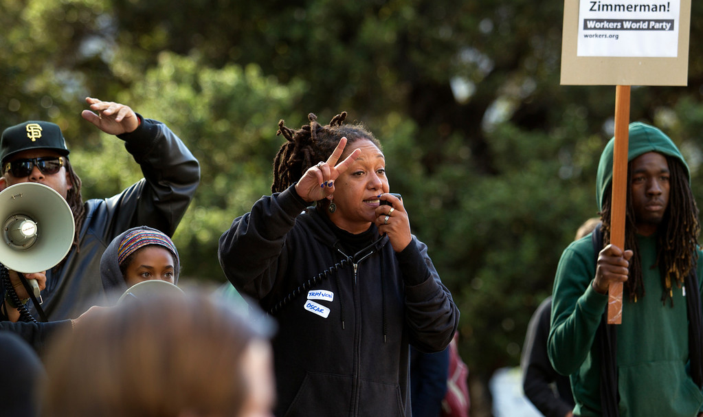 . ONYX Co-Chair Cat Brooks, center, speaks to the crowd at a protest of the verdict in the Trayvon Martin murder trial last Saturday in Sanford, Fla., Monday, July 15, 2013 at Frank H. Ogawa Plaza in Oakland, Calif. (D. Ross Cameron/Bay Area News Group)