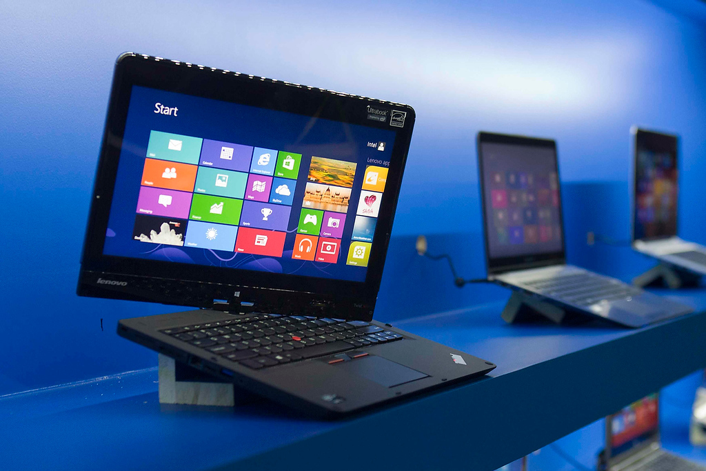 ". A convertible Lenovo Ultrabook is displayed at an Intel news conference during the Consumer Electronics Show (CES) in Las Vegas January 7, 2013. Intel announced improvements to its processors including one with ""all day\"" battery life. Intel also announced the availability of live and on-demand pay TV content to Intel devices. (REUTERS/Steve Marcus)"