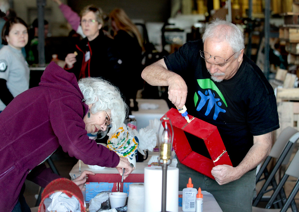 ". Local Habitat for Humanity Executive Director David Foster helps Sheila Carrillo fix a decorative piece for her home at ""Fix It Cafe\"" at Habitat\'s ReStore retail location on Swift Street on Monday, Jan. 21, 2013, in Santa Cruz, Calif. (Shmuel Thaler/Sentinel)"