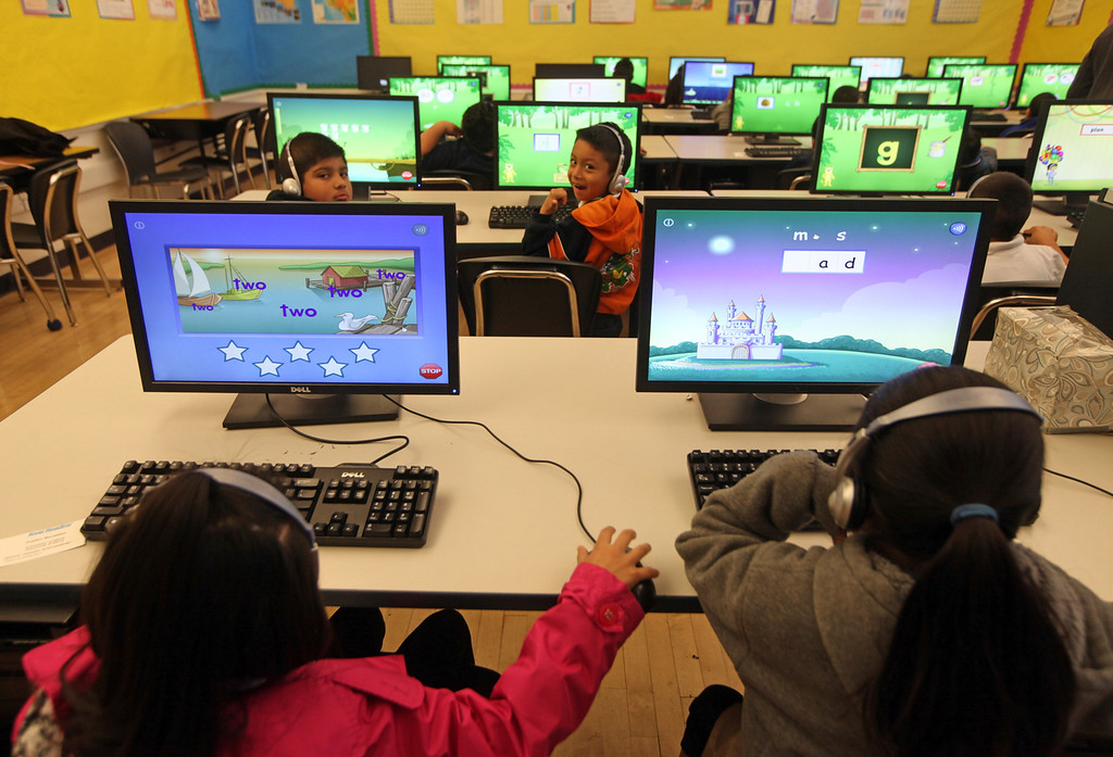 . First grade students get some time on learning software in the computer lab at Peres Elementary School in Richmond, Calif., on Friday, Feb. 8, 2013.  Peres school is one of two elementary schools in Richmond that have raised their average API test scores to over 800. (Laura A. Oda/Staff)