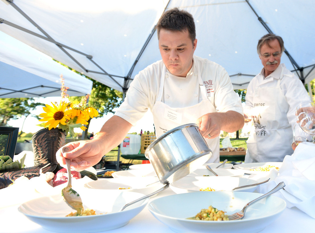 """. Matt Greco, the Chef at Livermore\'s Wente Vineyards restaurant, left, and Livermore Mayor John Marchand, prepare their plates of food in the final minutes of the \""""Alameda County Mayors\' Healthy Cook-Off Challenge\"""" held at the Dublin Farmers\' Market at Emerald Glen Park in Dublin, Calif., on Thursday, July 25, 2013. The Livermore team went on to take first place advancing them to compete against the winners of the Contra Cost County Mayors\' Healthy Cook-Off Challenge. The contest will be held at Mt. Diablo High School in the fall. The cook-off was presented by Concord\'s Wellness City Challenge and promotes the importance of healthy eating. (Doug Duran/Bay Area News Group)"""