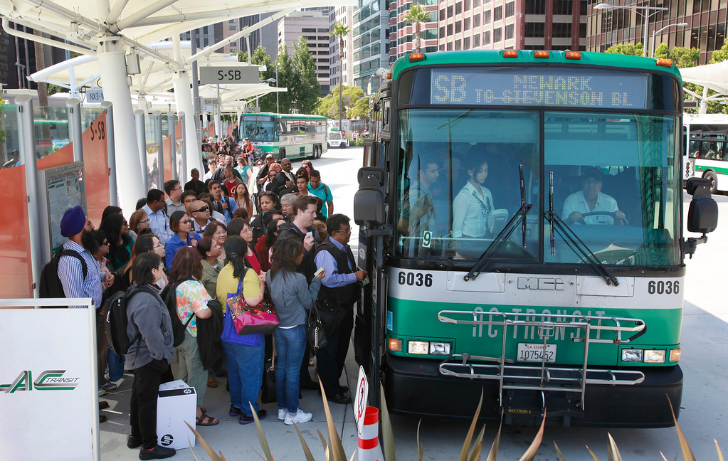 . AC Transit tries to handle long lines of commuters at the Temporary Transbay Termninal in downtown San Francisco, Calif., on the first day of the BART strike late Monday afternoon, July 1, 2013. (Karl Mondon/Bay Area News Group)