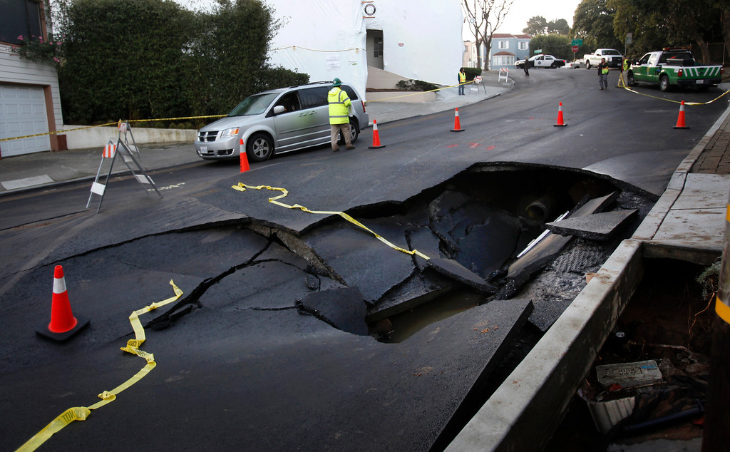 . San Francisco residents in the Inner Parkside neighborhood are digging out from a large water main break that flooded dozens of homes and cars at 15th Ave and Wawona Street Wednesday morning, Feb. 27, 2013.  (Karl Mondon/Staff)