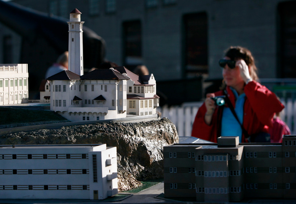 . Valerie Nestrude traveled from France to see Alcatraz but was able only to photograph the scale model of the island located in Fisherman\'s Wharf due to the partial government shutdown that closed San Francisco\'s top tourist attraction Tuesday, October 1, 2013. (Karl Mondon/Bay Area News Group)
