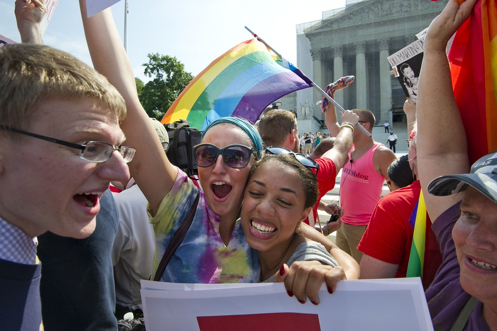 . Gay rights activists reacts outside the U.S. Supreme Court building in Washington, D.C., on June 26, 2013, after the court ruling on California\'s Proposition 8, the controversial ballot initiative that defines marriage as between a man and a woman. (Mladen Antonov/AFP/Getty Images)