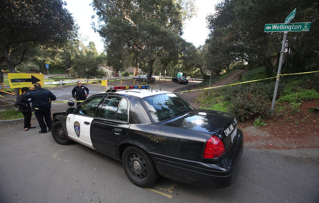 . Oakland police investigate the scene where a man was found dead of gunshot wounds on Canon Avenue and Wellington Street near Dimond Park in Oakland, Calif. on Friday, Jan. 11, 2013.  (Jane Tyska/Staff)