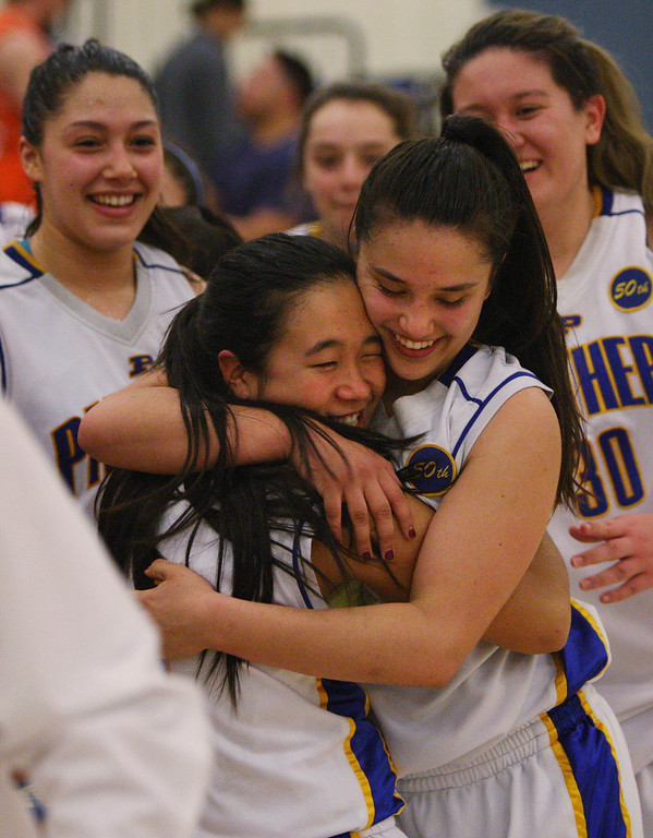 . Presentation\'s Ashley MacDonald, left, and Courtney Danna hug after the game during the CCS Division II girls basketball finals at Santa Clara High School in Santa Clara, Calif. on Friday, March 1, 2013. The Presentation Panthers beat the Woodside Wildcats, 49-34. (Jim Gensheimer/Staff)