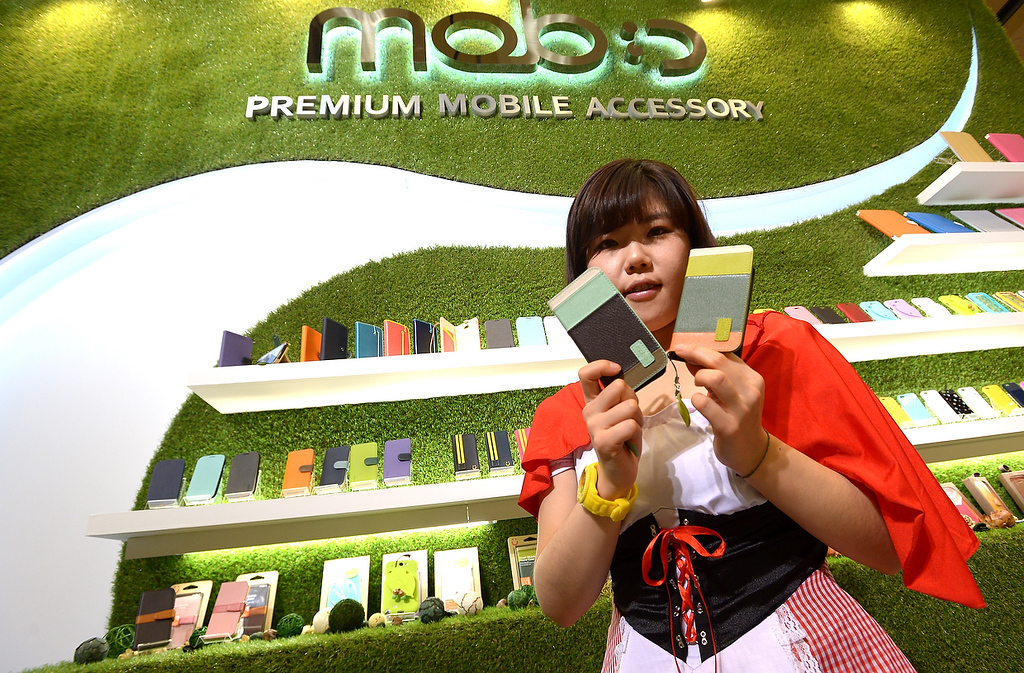 . A participant displays  phone accessories made by Mobstyle at the 2013 International CES at the Las Vegas Convention Center on January 8, 2013 in Las Vegas, Nevada. (JOE KLAMAR/AFP/Getty Images)