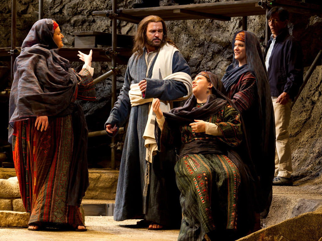 """. Yeshua (Nathan Gunn), center, is heckled by three women as he preaches at the Temple of Capernaum, in a scene from San Francisco Opera\'s world premiere of Mark Adamo\'s \""""The Gospel of Mary Magdalene,\"""" Sunday, June 16, 2013 at the War Memorial Opera House in San Francisco. (D. Ross Cameron/Bay Area News Group)"""