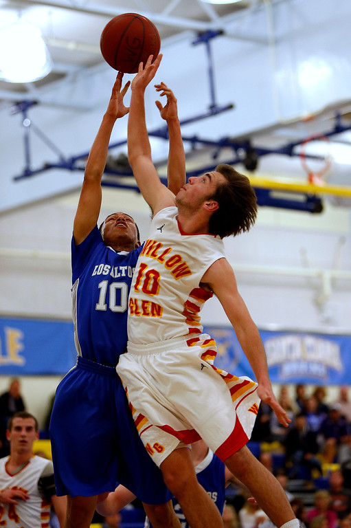. Los Altos High School\'s Nate Vieira (10) fights for a rebound against Willow Glen High School\'s Tucker Bacon (10) in the third period for the CCS Division II Boys Basketball semifinals at Santa Clara High School in Santa Clara, Calif., on Tuesday, Feb. 26, 2013.  Willow Glen High School won 59-57.  (Nhat V. Meyer/Staff)