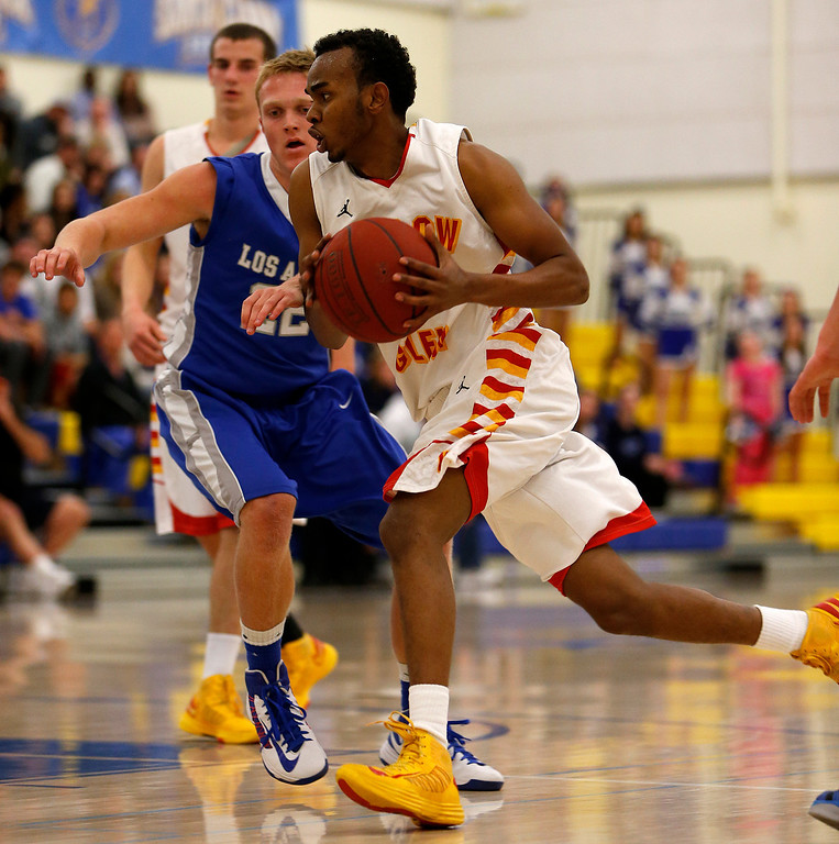 . Willow Glen High School\'s Hassan Abdi (15) heads to the basket against Los Altos High School\'s Kieran Stolorz (22) in the third period for the CCS Division II Boys Basketball semifinals at Santa Clara High School in Santa Clara, Calif., on Tuesday, Feb. 26, 2013.  Willow Glen High School won 59-57.  (Nhat V. Meyer/Staff)