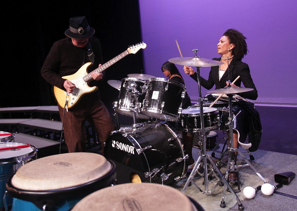. Carlos Santana and wife Cindy Blackman Santana play during an impromptu performance at San Leandro High School in San Leandro, Calif., on Wednesday, Jan. 9, 2013. (Anda Chu/Staff)
