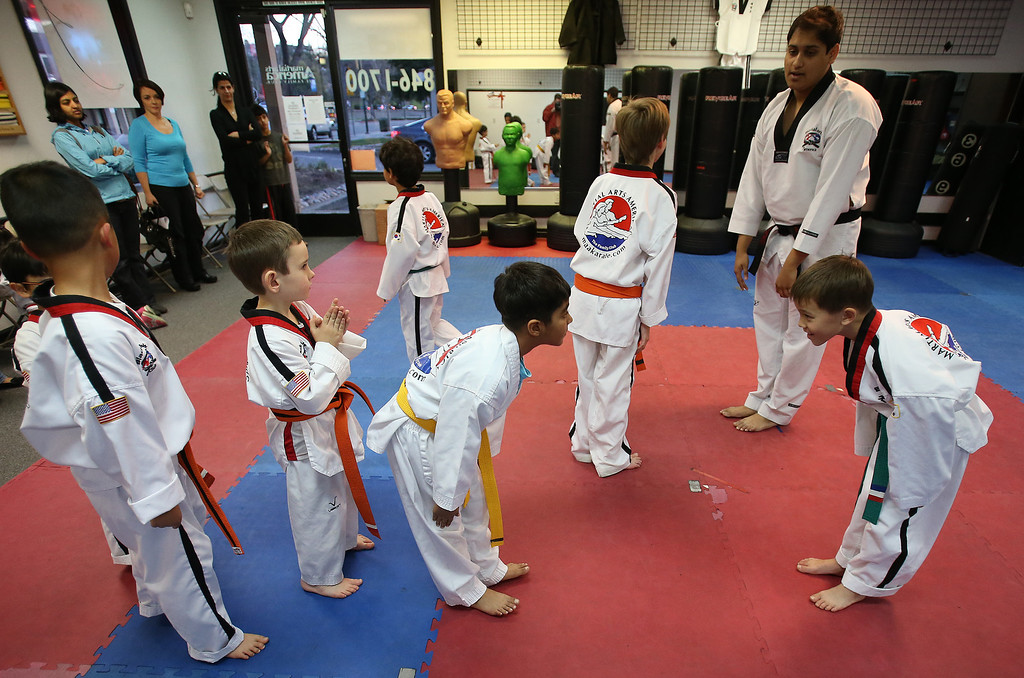 . Sammy Masek, 6, second from left, finishes his martial arts class on Monday, Feb. 11, 2013 in Pleasanton, Calif.  Masek is one of a growing number of children that have lost their diagnosis of autisim.  (Aric Crabb/Staff)