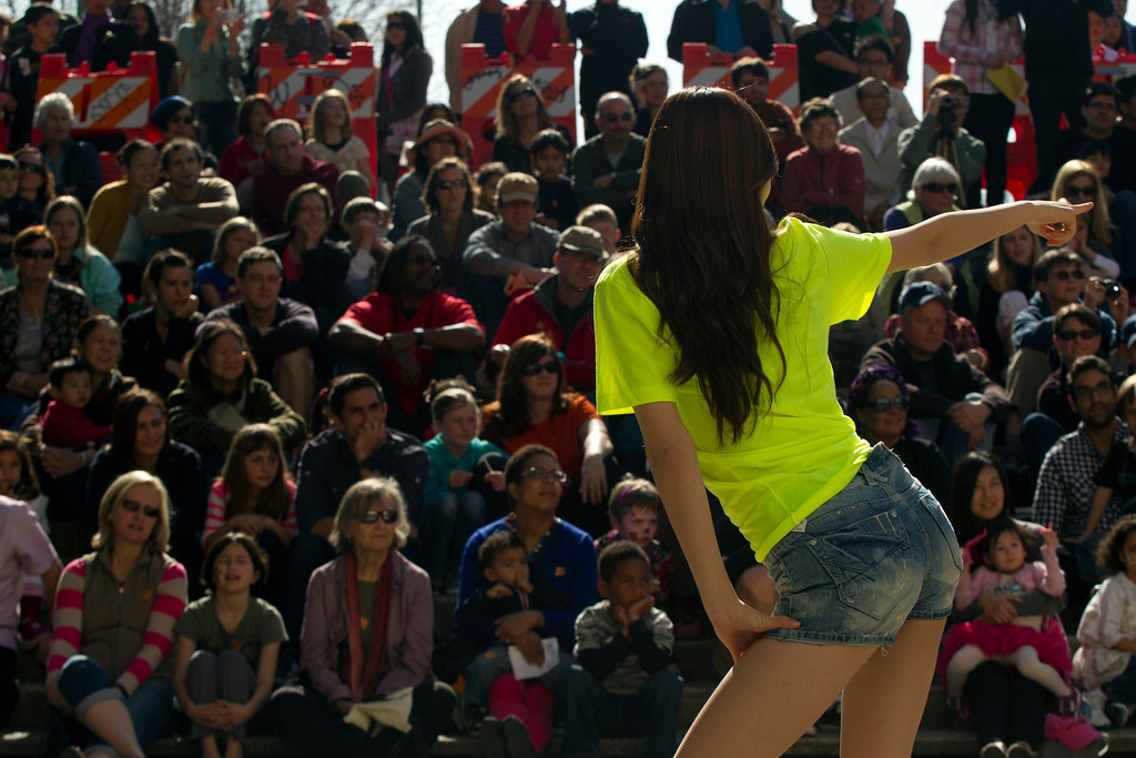 ". An unidentified member of the Korean Performance Group from the University of California dances ""Gangnam Style,\"" during the Oakland Museum of California\'s Lunar New Year celebration, Sunday, Feb. 17, 2013 in Oakland, Calif. (D. Ross Cameron/Staff)"