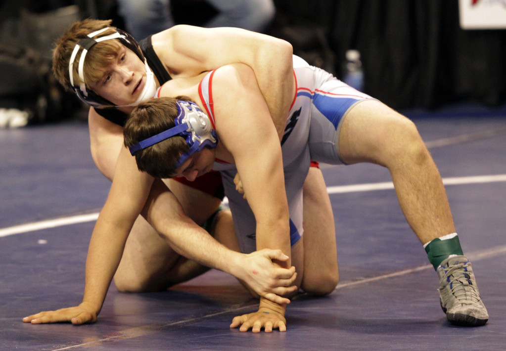 . James Logan\'s Clayton Hartwell, left, wrestles Durham\'s Tyler Hughes in a 195-pound first round match during the California Interscholastic Federation wrestling championships in Bakersfield, Calif., on Friday, March 1, 2013. Hartwell would go on to win the match. (Anda Chu/Staff)
