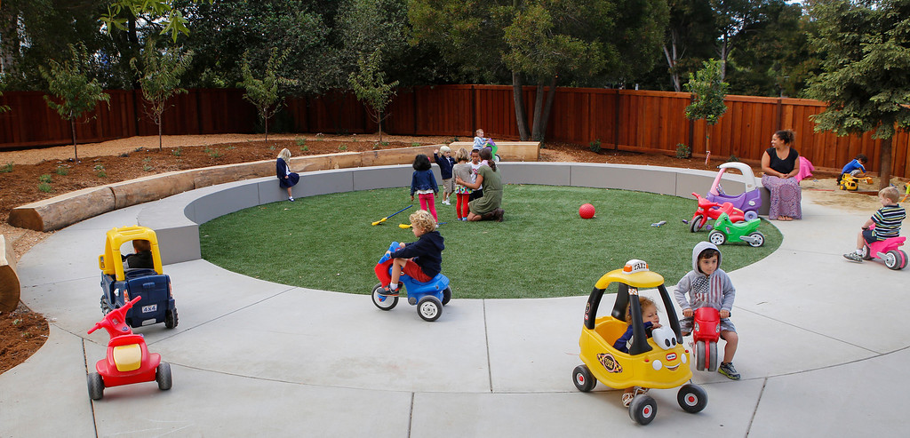 . Kids play in the outdoor playground of the newly constructed Early Childhood Center at Charles House in San Mateo, Calif., on Tuesday, Sept. 10,  2013. (John Green/Bay Area News Group)