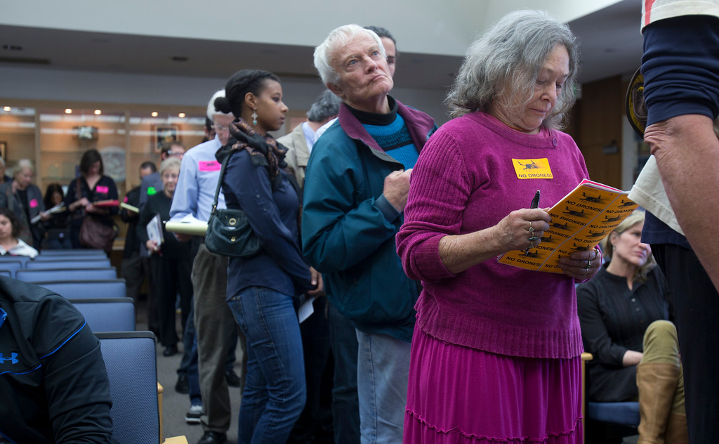 . Audience members wait to speak during the public comment period of a hearing on the Alameda County Sheriff\'s plan to acquire a drone for aerial enforcement, Thursday, Feb. 14, 2013 at the Alameda County Administration Building in Oakland, Calif. (D. Ross Cameron/Staff)