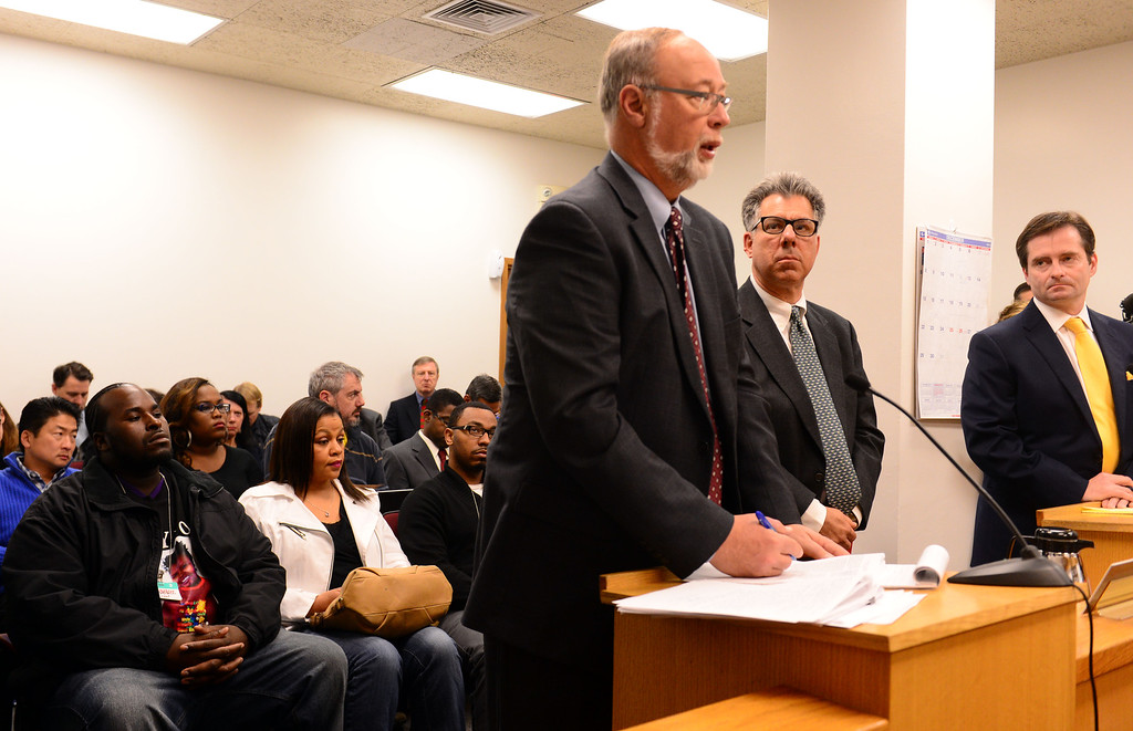 . Members of Jahi\'s family, from left, stepfather Martin Winkfield, grandmother Sandra Chatman, and uncle Omari Sealey look on from their front row seats as Oakland\'s Children\'s Hospital attorney Douglas C. Straus, left, addresses Judge Evelio Grillo while standing next to Dr. Paul Fisher, center, and attorney Christopher Dolan in Department 31 of the Alameda County Superior Court in Oakland, Calif., on Tuesday, Dec. 24, 2013. The hearing was held to determine the fate of Jahi McMath, a brain-dead 13-year -old girl, at Children\'s Hospital. Judge Grillo on Tuesday denied a petition by the family of McMath to have Children\'s Hospital Oakland keep the teen on a ventilator past Dec. 30. (Susan Tripp Pollard/Bay Area News Group)