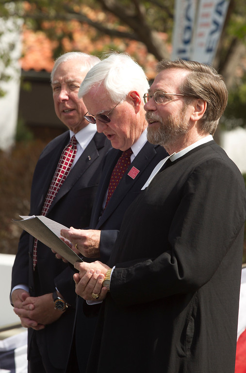 . Newly-named St. Mary\'s College President James A. Donahue, center, sings the college\'s alma mater between Russell Harrison and Br. Donald Johanson, at a ceremony announcing his new position, Tuesday, March 26, 2013 in Moraga, Calif. (D. Ross Cameron/Staff)