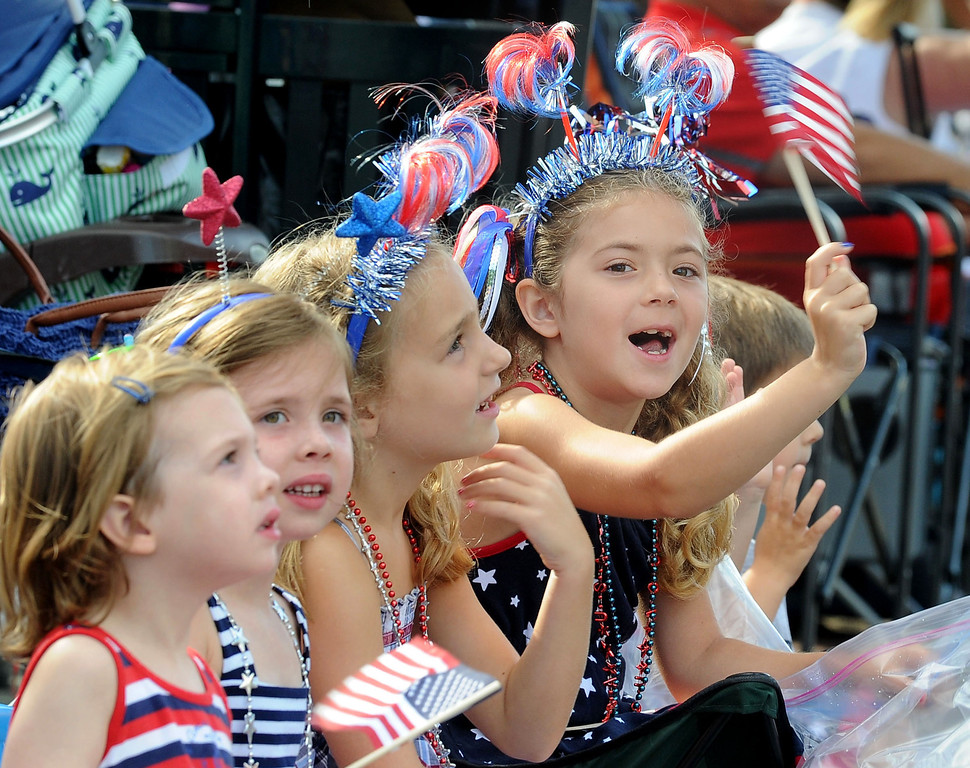 . Addison Crawford, 6, of Danville, right, sits with her sister and friends as she watches the 4th of July Parade in Danville, Calif., on Thursday, July 4, 2013. The parade, sponsored by the Kiwanis Club of San Ramon Valley, features about 120 entries with an estimated 40,000 spectators attending. (Doug Duran/Bay Area News Group)