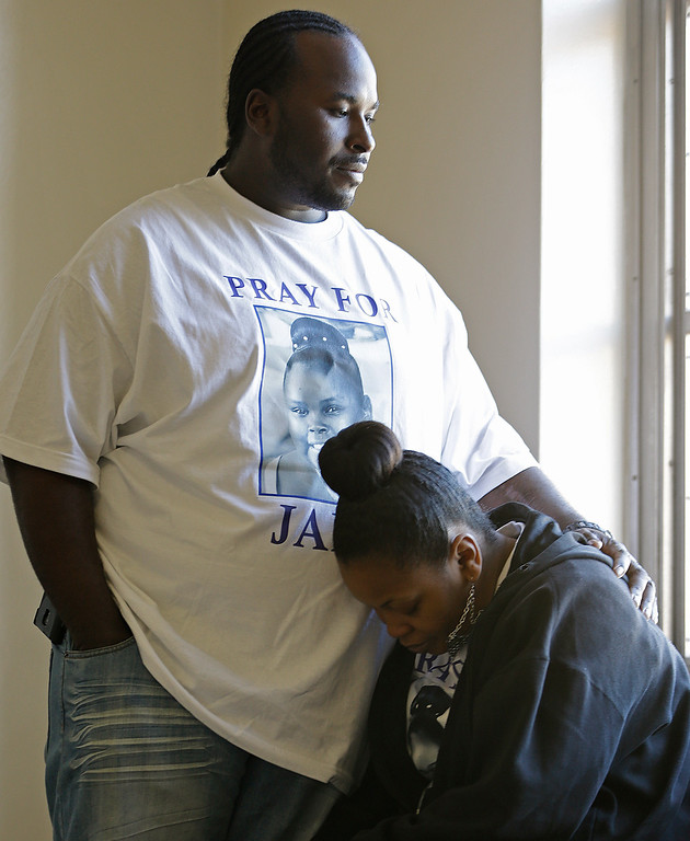 . Martin Winkfield places his arm around his wife Nailah Winkfield, mother of 13-year-old Jahi McMath, as they wait outside a courtroom Friday, Jan. 3, 2014, in Oakland, Calif. A federal magistrate was expected to meet Friday with lawyers to try to resolve a dispute over the care ofJahi McMath, who was declared brain dead after tonsil surgery. (AP Photo/Ben Margot)