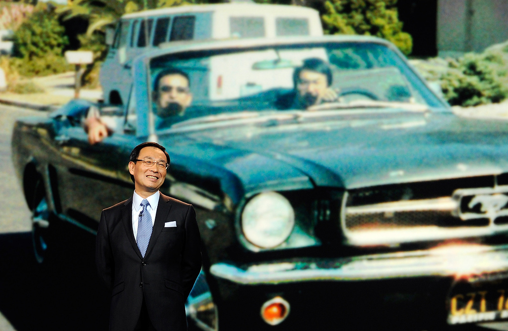 . Panasonic Corporation President and CEO Kazuhiro Tsuga speaks during a keynote address with an image with Tsunga in his 1965 Mustang behind him at the 2013 International CES at The Venetian on January 8, 2013 in Las Vegas, Nevada. (Photo by David Becker/Getty Images)