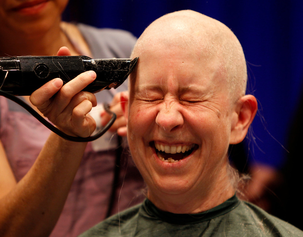. Pia Chamberlain has her head shaved for the St. Baldrick\'s Day head shaving event in support of research for pediatric cancer sponsored by the St. Baldrick\'s Foundation in the NetApp gymnasium at NetApp in Sunnyvale, Calif., on Thursday, March 14, 2013.  (Nhat V. Meyer/Staff)