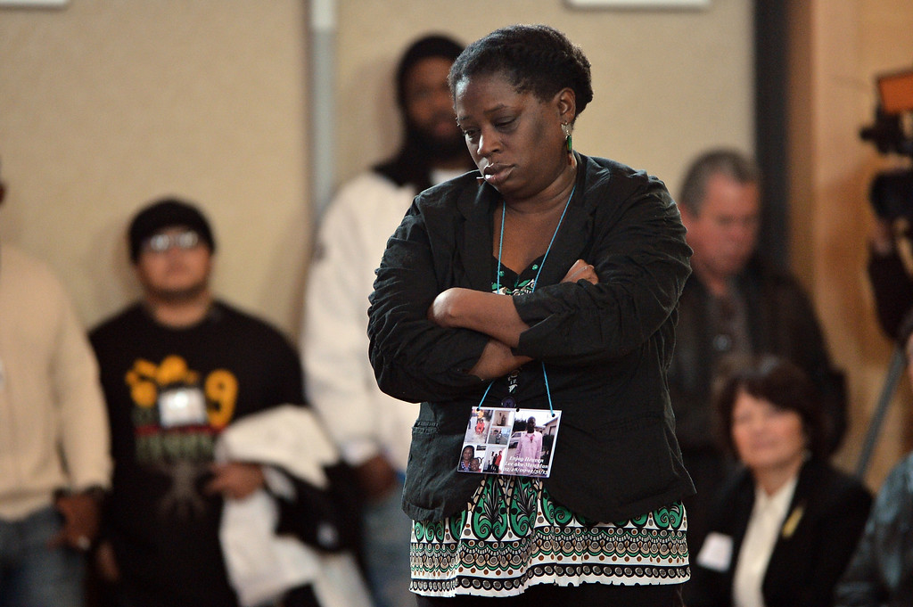. Dinyal New, mother of slain teenager Lee Weathersby III, prepares to speak at a memorial service for her son held at Alliance Academy in Oakland, Calif. on Wednesday, Jan. 8, 2014. (Kristopher Skinner/Bay Area News Group)