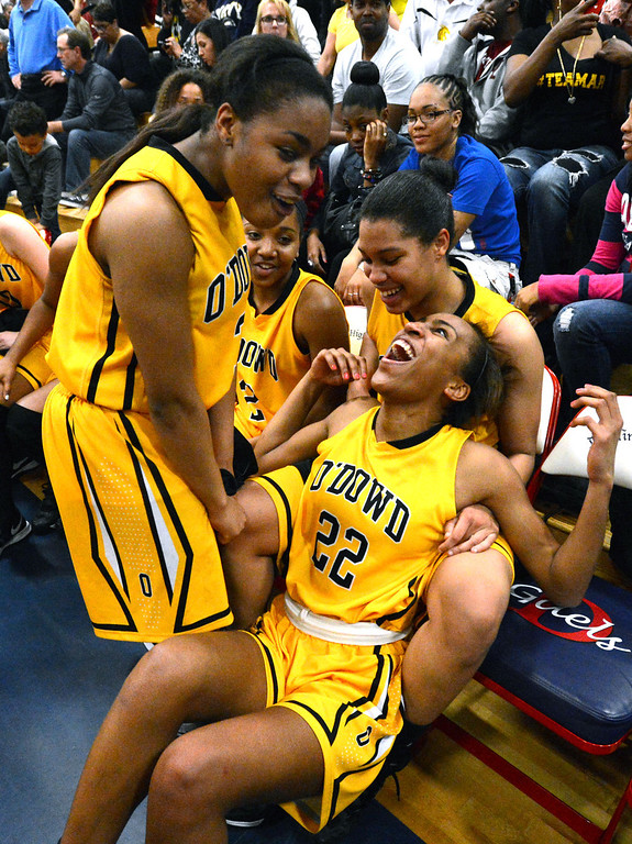 . From left, Bishop O\'Dowd High\'s Ariell Bostick (3), Oderah Chidom (22) and Breanna Brown (4) celebrate after their team won their Division III North Coast Section basketball game 77-48 against Miramonte High in Dublin, Calif., on Saturday, March 2, 2013. (Doug Duran/Staff)