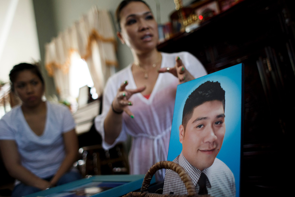 . The Nguyen family believes there may be foul play behind the death of Vince Canh Xuan Nguyen, shown in a photo at right, who passed away in a tiny hotel room in Vietnam on July 1, 2013, after a night of drinking ended with him gravely ill, unable to control his body functions. Pictured are his sisters Sharon Nguyen, center, and Dee Nguyen. (Dai Sugano/Bay Area News Group)