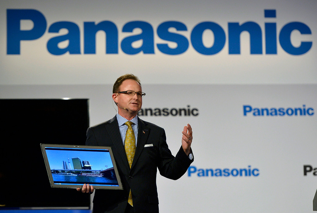 """. Rance Poehler, president of Panasonic Company of North America, shows off the new 20\"""" tablet during the Panasonic news conference at the 2014 International Consumer Electronics Show Monday, Jan. 6, 2014, in Las Vegas. (AP Photo/Jack Dempsey)"""