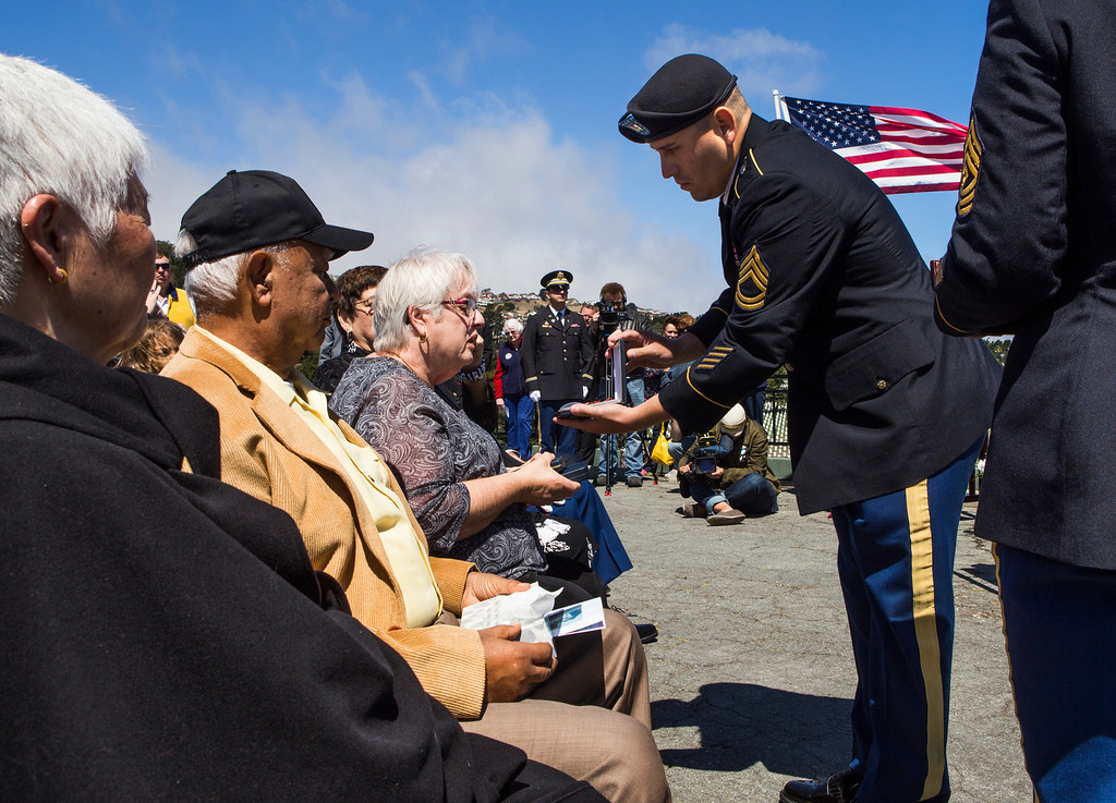. Marlene Baisa, middle, the niece of Sgt. 1st Class Joseph Steinberg is presented service medals for her late uncle by a member of the honor guard at Golden Gate National Cemetery in San Bruno, Calif., on Aug. 1, 2013. (John Green/Bay Area News Group)
