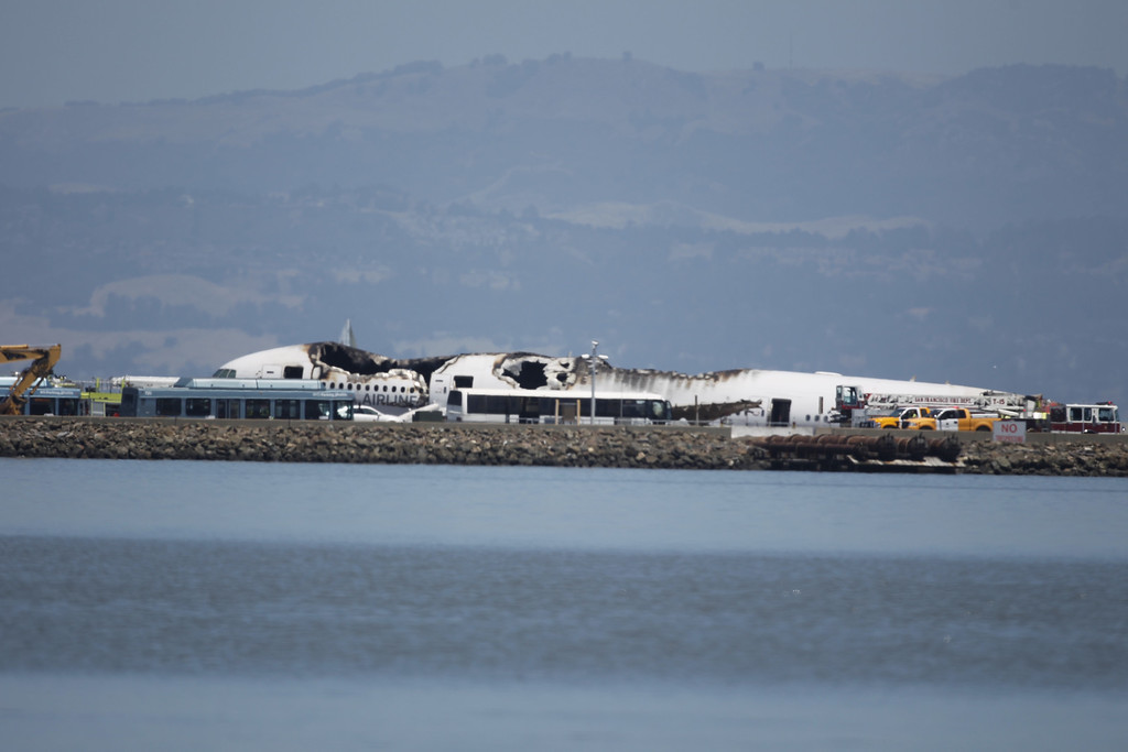 . The crashed fuselage of Asiana Airlines Flight 214, a Boeing 777 arriving from Seoul, South Korea, is seen on runway 28L at San Francisco International Airport, on Saturday July 6, 2013 (LiPo Ching /Bay Area News Group)