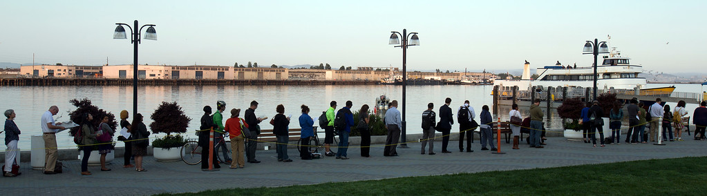 . A long line of ferry riders wait to board a boat at Jack London Square, as BART commuters scrambled to find alternative routes to San Francisco on the first day of a strike by workers of the mass transit system, Monday, July 1, 2013 in Oakland, Calif. (D. Ross Cameron/Bay Area News Group)