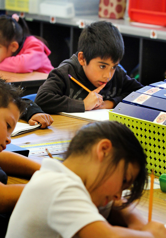 . Second grader Jonathon Batres  is deep in thought about a multiplication problem during class at Peres Elementary School in Richmond, Calif., on Friday, Feb. 8, 2013.  Peres school is one of two elementary schools in Richmond that have raised their average API test scores to over 800. (Laura A. Oda/Staff)