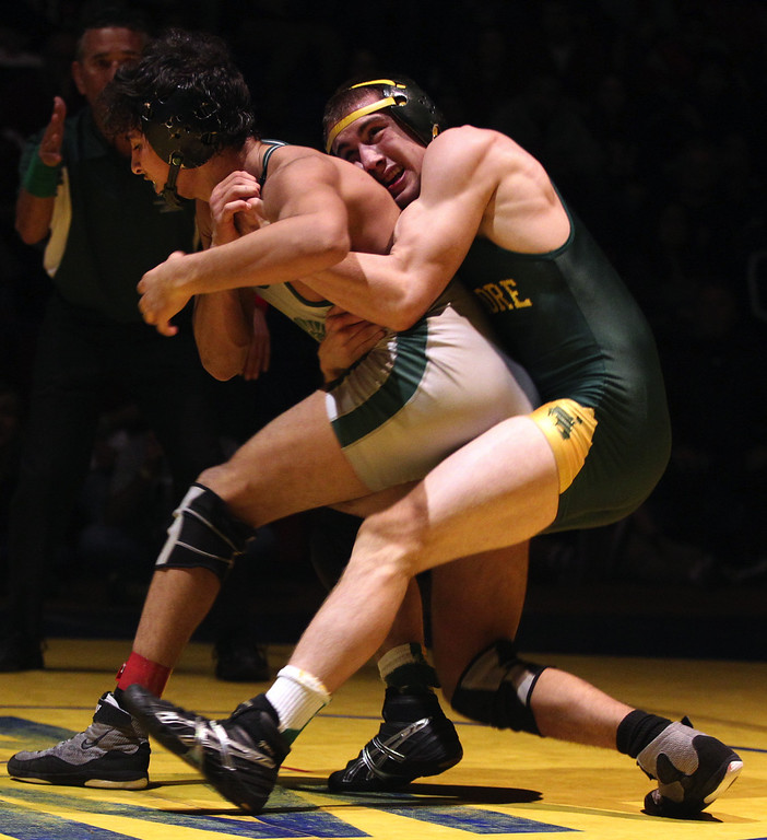 . De La Salle\'s Payton Russum, left, wrestles Livermore\'s Nicolas Lang in the 145-pound finals at the North Coast Section wrestling championships held at Newark Memorial High School in Newark, Calif., on Saturday, Feb. 23, 2013. Lang would get the win. (Anda Chu/Staff)