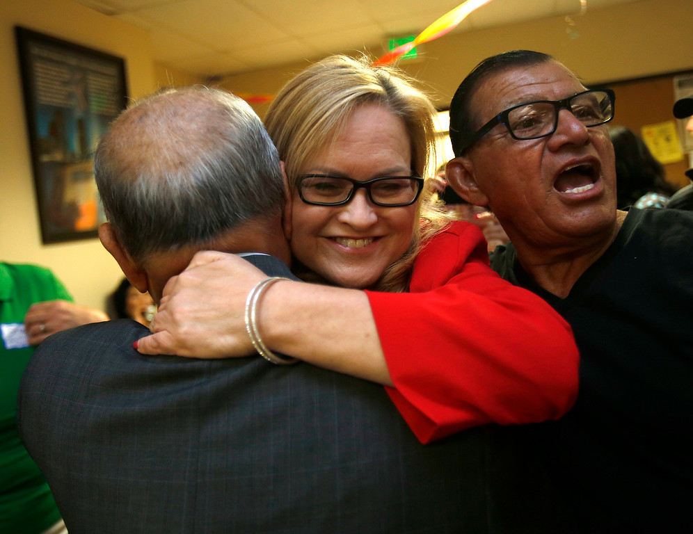 . Cindy Chavez, center, gets a hug from Bing Khac Nguyen, left, on election night for the Santa Clara County District 2 supervisor at the South Bay AFL-CIO Labor Council headquarters in San Jose, Calif. on Tuesday, July 30, 2013.  (Nhat V. Meyer/Bay Area News Group)