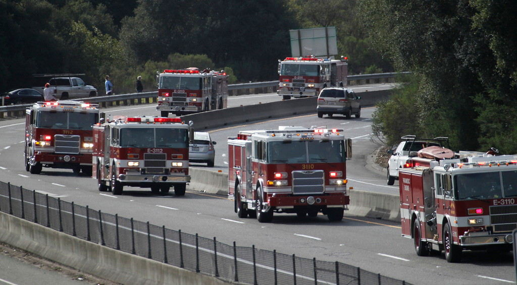 ". A procession of firefighters and police officers from supporting agencies, coming from Santa Cruz heads north on Highway 17 near Bear Creek Road on their way to HP Pavilion in San Jose Thursday, March 7, 2013. The procession was to the memorial service for Santa Cruz city police officers Loran ""Butch\"" Baker and Elizabeth Butler, shot to death on Feb. 26 when they followed up on a sexual assault investigation with an unstable man with a history of sexual assault. The gunman, Jeremy Goulet, was killed moments later by responding Santa Cruz County sheriff\'s deputies.  (Patrick Tehan/Staff)"