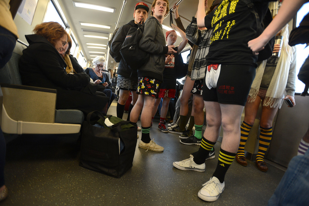 ". Underwear formal and casual was out in force along with colorful socks during the ""12th Annual No Pants Subway Ride\"" in Oakland, Calif. on Sunday, Jan. 13, 2013. BART riders joined those in New York, Berlin and Mexico that all participated in the annual event. Many traveled to Civic Center BART to meet up for a group photo in San Francisco. (Susan Tripp Pollard/Staff)"
