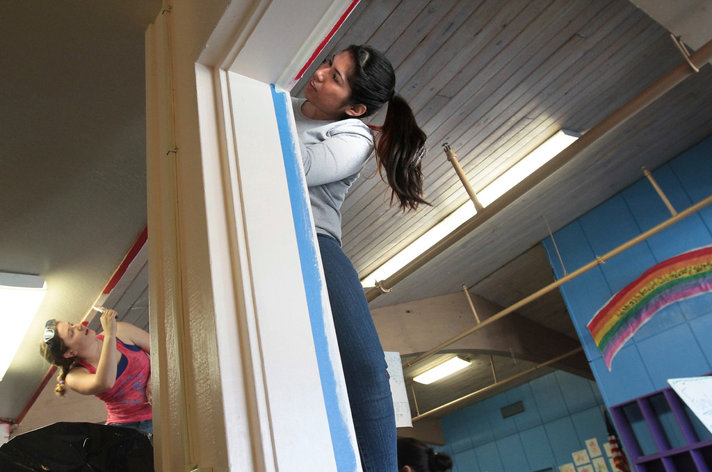 . Shira Hillinger and Destinee Soto join a dozen of their UCSC Kappa Zeta sorority sisters for a day of painting, cleaning and gardening at the Boys and Girls Club of Santa Cruz, Calif., on Monday, Jan. 21, 2013. (Shmuel Thaler/Sentinel)